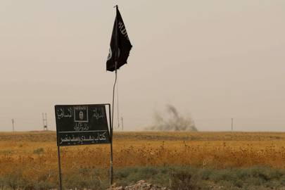 An Islamic State flag and banner near the city of Kirkuk, Iraq