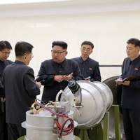 September 3 2017: North Korean leader Kim Jong-Un examines what appears to be a hydrogen bomb