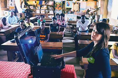Jessica Tribbe, of Unicef's Uganda Innovation Lab, demonstrates the Mobi-Case to teachers at Seeta CU school