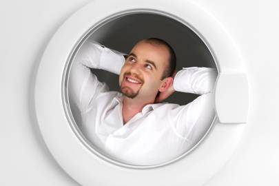 """Young man has relax time inside of washing machine"""