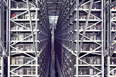 A stacker crane zips along a 12.5m-tall aisle in a Yoox warehouse near Bologna