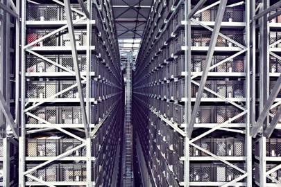 A stacker crane zips along a 12.5m-tall aisle in a Yoox warehouse near Bologna