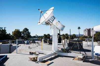 An antenna, perched on a roof in Woodland Hills, California, is designed to exchange data with a sister antenna in the air