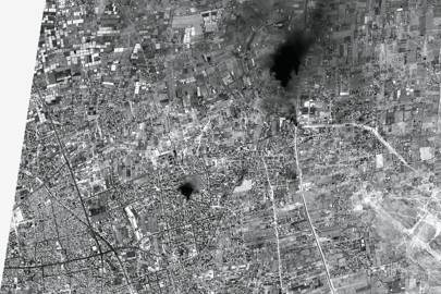 At 11.39am on August 1, 2014, a European satellite called Pleiades happened to be passing over Gaza and took a single, high resolution photograph. This image is a rare insight into the day of conflict as it developed. It is possible to see a recent explosion, areas burning and tanks moving into position. The resolution of 50 centimetres per pixel was previously unavailable for satellite images of Gaza because of the US monopoly and a US-Israeli agreement that forced all satellite images of the area to be masked by a low-resolution veil -- European satellites do not have such restrictions.