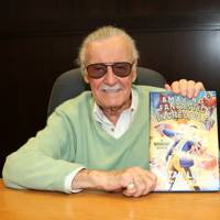 Stan Lee poses with his memoir