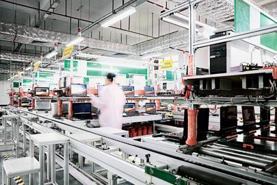 Laptops are loaded with software in a PCH factory