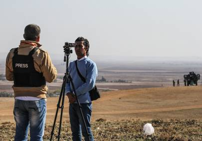 Members of the press pictured near a Turkish-Syrian border crossing in November 2014