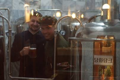 Josh Thomas (left) visiting the Yanggakdo Hotel Microbrewery