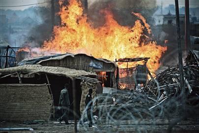 A village is razed near Kadugli in June 2011