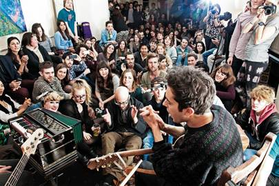 Around 100 people pile into someone's front room in Hampstead for a gig with band Khushi