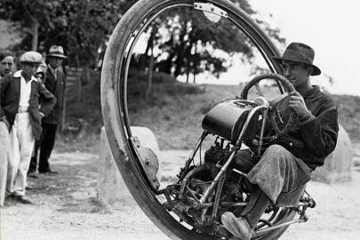 A Swiss engineer known as Mr. Gerdes designed this monowheel. It is pictured here, ridden by a man who may or may not be Mr. Gerdes, apparently on a trip to Spain in 1931