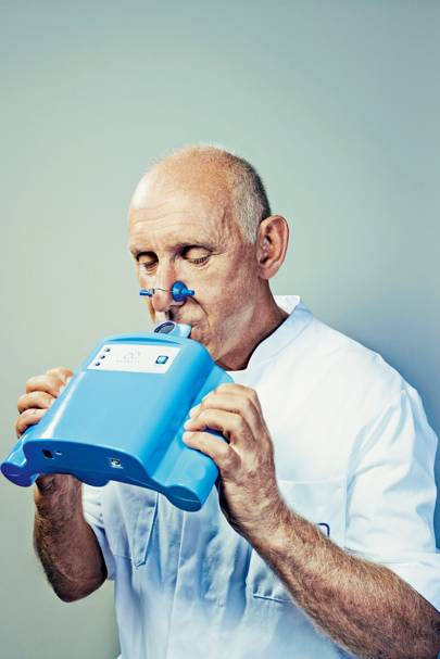 Tjip van der Werf of the University of Groningen blows into an eNose Aeonose diagnostic unit