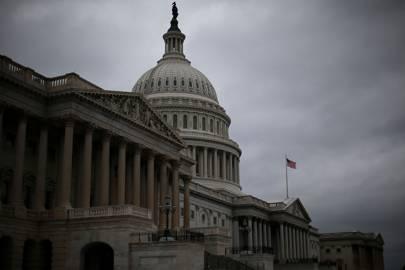 US Capitol building under cloud skies