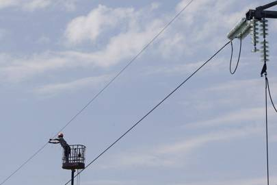 A worker repairs power lines in the eastern Ukrainian town of Slavyansk