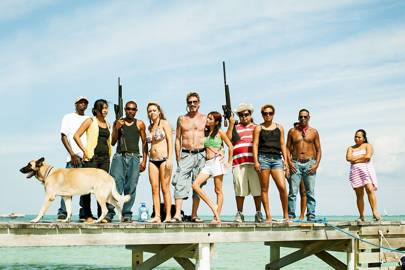 While in Belize, McAfee collected a retinue of dogs, bodyguards and young women