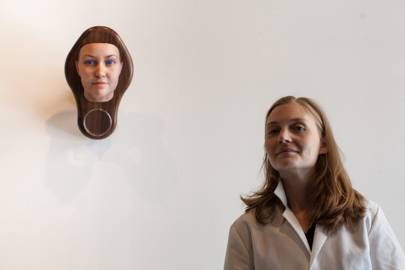 Artist Heather Dewey-Hagborg with one of the 3D-printed heads