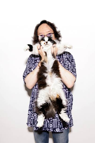 """I started writing songs for cats because I'd got bored writing songs for humans,"" says Hideo Saito (with Seri)"