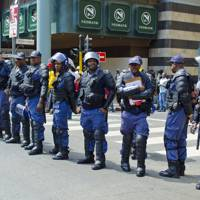 South African police officers on duty at a protest in Johannesburg in response to the massacre of the Marikana miners