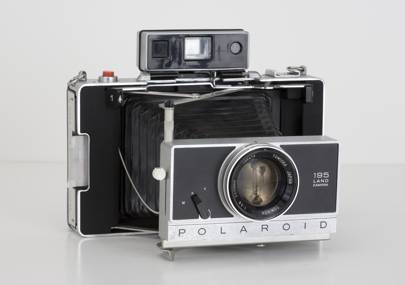 An American-made Polaroid Land Camera Model 195 instant film camera (circa 1971)