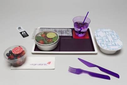 The goal of the redesign was to make airline meal service feel more like a restaurant with multiple courses served over time. Food isn't deposited into cavities on a pre-molded tray; instead custom designed dishes and flatware are carefully arranged on the skid-proof surface