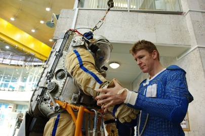 ESA astronaut Tim Peake inspecting a Russian Orlan suit during training at the Gagarin Cosmonaut Training Centre near Moscow. The Orlan suit allows astronauts and cosmonauts to venture outside the International Space Station for up to 7 hours to install new equipment or conduct maintenance and repair.