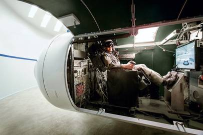 Michael Mills, an aerospace physiology specialist, in the centrifuge at Wyle's San Antonio facility. It is capable of 30 g