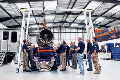 Bloodhound's EJ200 jet engine is lowered on to a  storage cradle for inspection using a hand-operated pulley