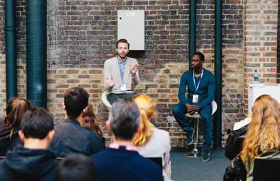 Tim Groot, cofounder and CEO of artificial intelligence-powered event networking solution Grip (left) and Pierre-Simon Ntiruhungwa, head of programming at Founders of the Future (right) speaking at WIRED Next Generation