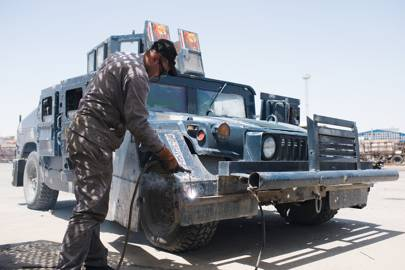 One of the Iraqi Federal Police's modified blue Humvees