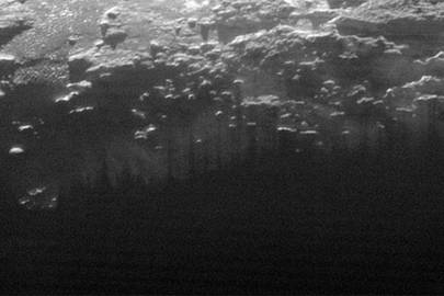 In this image low-level hazy fog can be seen above Pluto's surface
