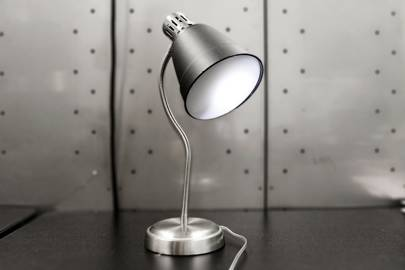 Brian House and Kyle McDonald's creation, the Conversnitch, impersonates a lightbulb or lamp while eavesdropping on and livetweeting nearby conversations