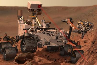 An artist's impression of the Curiosity Rover using its laser spectrometer