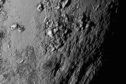 First Pluto flyby image reveals 3,300m ice mountains