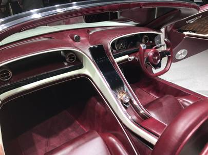 The interior central console is one solid section of curved glass leading up to a high-definition OLED screen