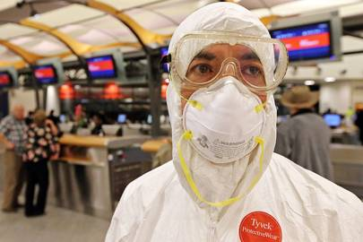 Two days after a man in Texas was diagnosed with Ebola, Dr. Gil Mobley of Missouri showed up to his Thursday morning flight out of Atlanta's Hartsfield-Jackson International Aitrport dressed in protective gear to protest what he called mismanagement of the crisis by the CDC