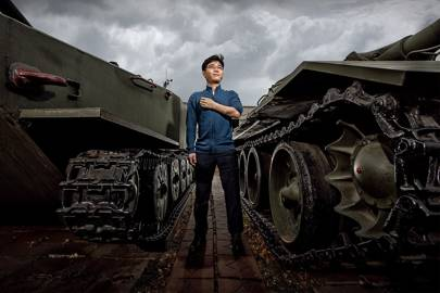 Ji Seong-ho stands in front of decommissioned Chinese Type 63 tanks used in the Korean War, now part of the War Memorial of Korea in Seoul