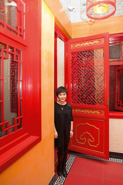 Melissa Yang, co-founder of Tujia, outside a property available to rent in the Dongcheng District, Beijing