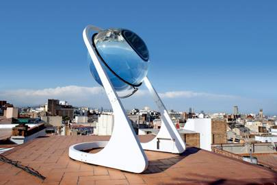 The Rawlemon's orb concentrates diffused light onto a photovoltaic panel which moves as it tracks the sun. Andre Broessel says it is 35 per cent more efficient than regular panel arrays