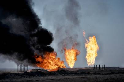Burning off natural gas from the oil fields in Rumaila, southern Iraq. Middle East.