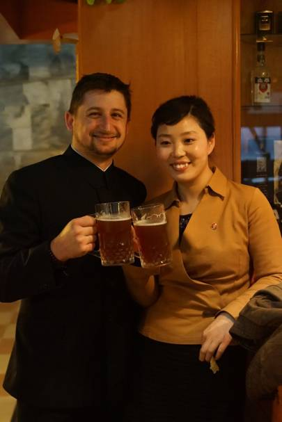 Josh Thomas and Ms Yu, one of the North Korean guides, enjoy draft beers at the bar of the Yanggakdo Hotel Microbrewery
