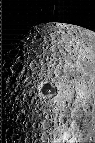 The prominent feature in this image, taken by Lunar Orbiter 3 on 19 February 1967, is Tsiolkovskiy, a large impact crater located on the far side of the Moon