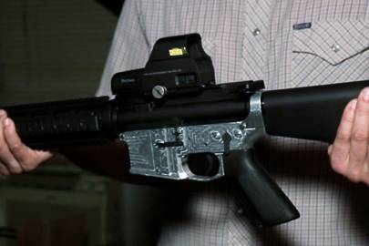 A milled AR-15 lower receiver with the stock, barrel and other components attached. The finished weapon has no serial number
