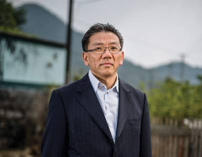 Ken Yeung, CEO of the TOM group, photographed by WIRED in the village of Zan Gong