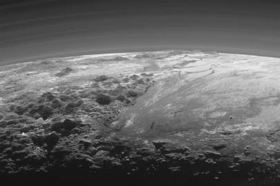 Taken 15 minutes after New Horizons' closest approach to Pluto, this panorama captures a view of the Sun setting over the distant, icy world