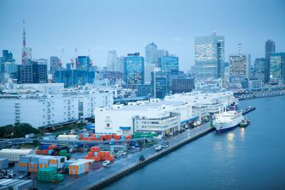 High-rise flats and docklands next to Rainbow Bridge in Tokyo at dusk