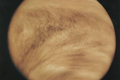 Wind speeds of 224mph keep Venus' thick atmosphere in constant, dizzying motion. While it takes 243 Earth days to complete one rotation on its axis, clouds fly around once every four days. Rain falls as sulphur dioxide and sulphuric acid, with surface temperatures hitting 462 degrees C. There's also lightning on Venus.