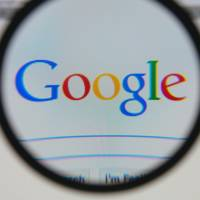 Google logo through a lens
