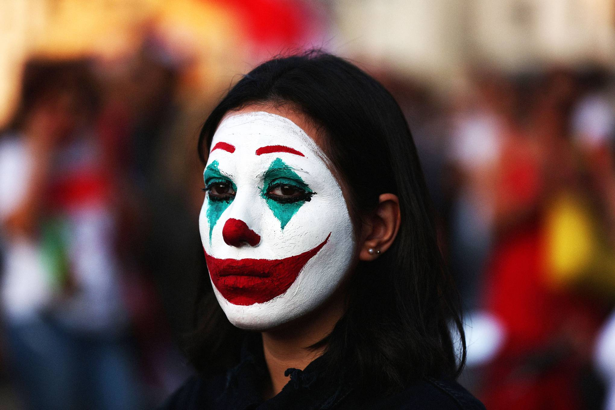 Why Joker masks are the perfect political protest symbol