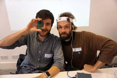 Giovanni Puntil and Christian Axenie try out their prototype for HearSee, which translates motion to sound