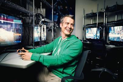 Jason Jones, cofounder of Bungie, surrounded by Playstation 4 developer kits, all running Destiny